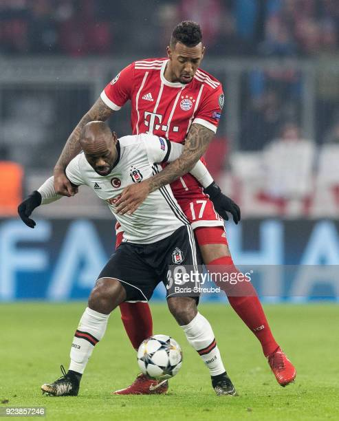 Jerome Boateng of FC Bayern Muenchen battles for the ball with Vagner Love during the UEFA Champions League Round of 16 First Leg match between...