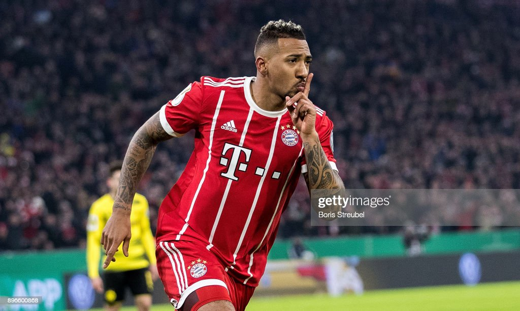 Jerome Boateng of FC Bayern Muenchen celebrates after scoring his team's first goal during the DFB Cup match between Bayern Muenchen and Borussia Dortmund at Allianz Arena on December 20, 2017 in Munich, Germany.