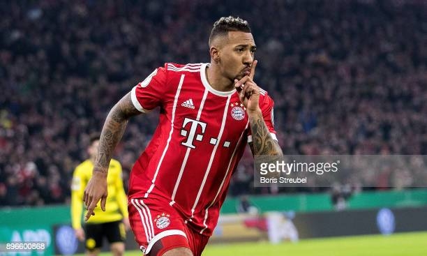 Jerome Boateng of FC Bayern Muenchen celebrates after scoring his team's first goal during the DFB Cup match between Bayern Muenchen and Borussia...