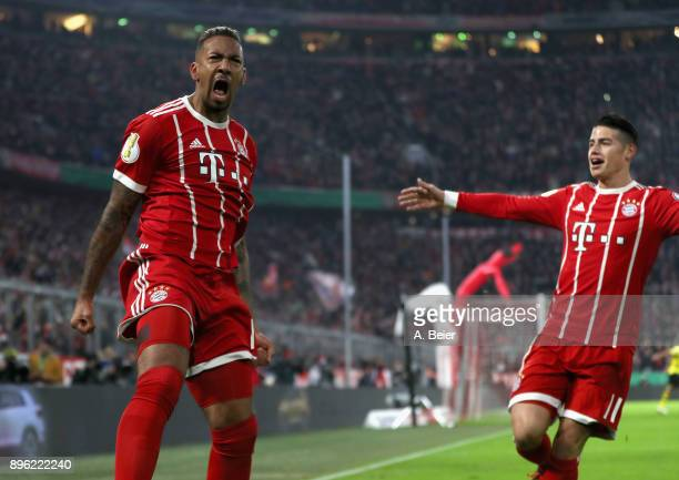 Jerome Boateng of FC Bayern Muenchen celebrates his first goal together with teammate James Rodriguez during the DFB Cup round of sixteen match...