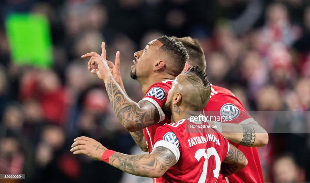 Jerome Boateng of FC Bayern Muenchen celebrates with team mates after scoring his team's first goal during the DFB Cup match between Bayern Muenchen and Borussia Dortmund at Allianz Arena on December 20, 2017 in Munich, Germany.