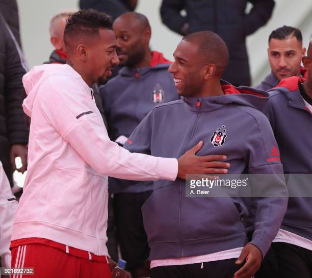 Jerome Boateng of FC Bayern Muenchen chats with Ryan Babel of Besiktas in the players' tunnel before the UEFA Champions League Round of 16 first leg...