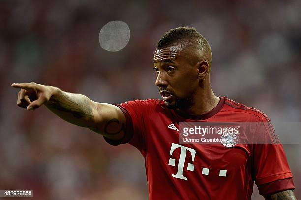 Jerome Boateng of FC Bayern Muenchen gestures during the Audi Cup 2015 match between FC Bayern Muenchen and AC Milan at Allianz Arena on August 4...