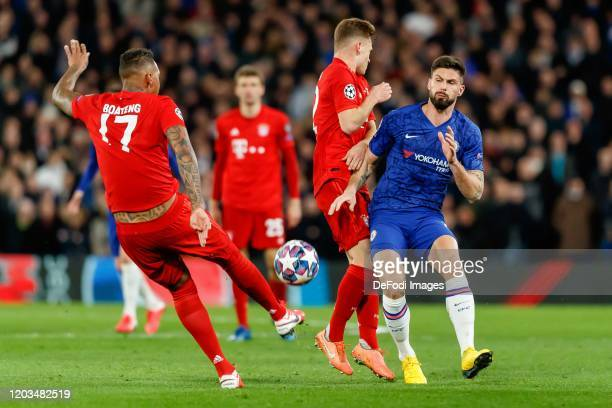 Jerome Boateng of FC Bayern Muenchen Joshua Kimmich of FC Bayern Muenchen and Olivier Giroud of Chelsea FC battle for the ball during the UEFA...