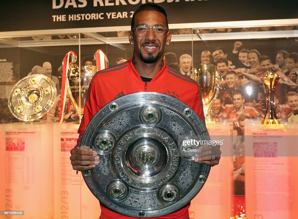 Jerome Boateng Hands Over  Championship Trophy To FCB Erlebniswelt