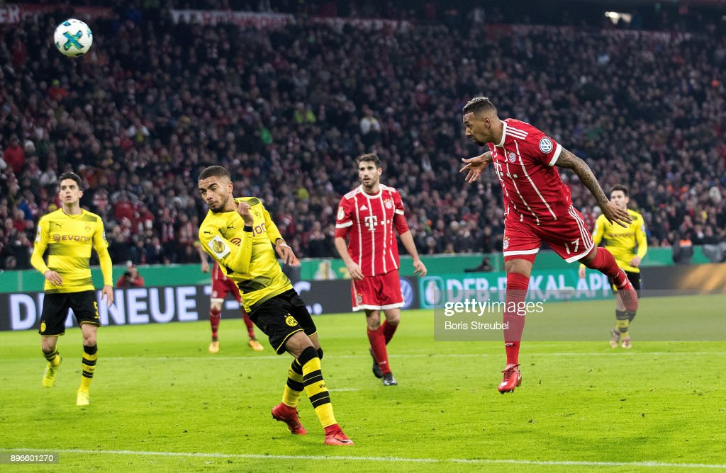 Jerome Boateng of FC Bayern Muenchen scores his team's first goal with a header during the DFB Cup match between Bayern Muenchen and Borussia Dortmund at Allianz Arena on December 20, 2017 in Munich, Germany.