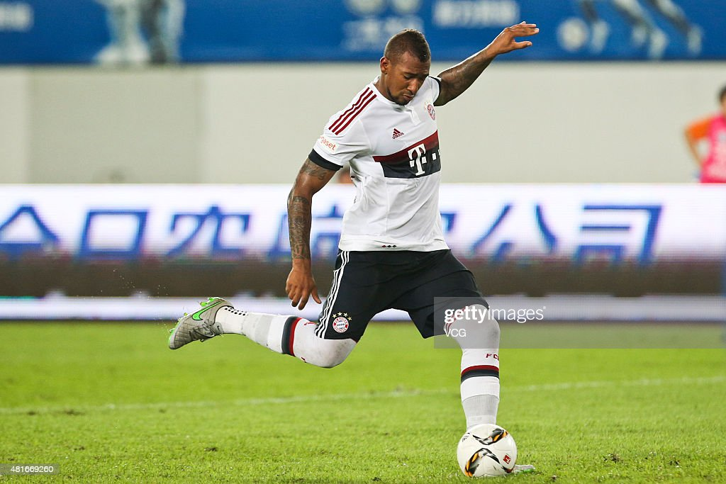 Jerome Boateng #17 of FC Bayern Muenchen scores the third penalty kick at the penalty shootout during the international friendly match between Guangzhou Evergrande and FC Bayern Muenchen of the Volkswagen Cup Guangzhou at Tianhe Stadium on July 23, 2015 in Guangzhou, China.