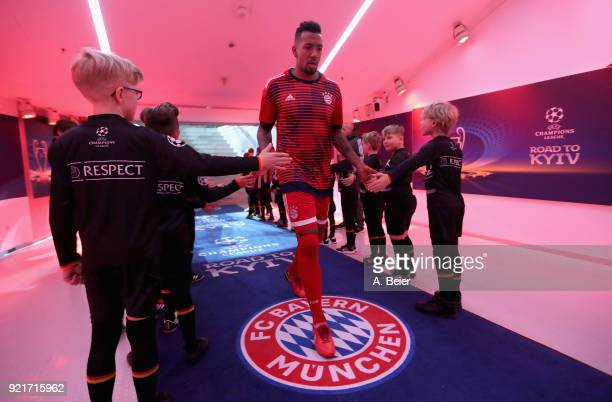 Jerome Boateng of FC Bayern Muenchen shakes hands with the kids escort at the players' tunnel before the UEFA Champions League Round of 16 first leg...