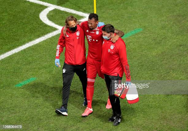 Jerome Boateng of FC Bayern Munich leaves the pitch injured during the UEFA Champions League Final match between Paris Saint-Germain and Bayern...