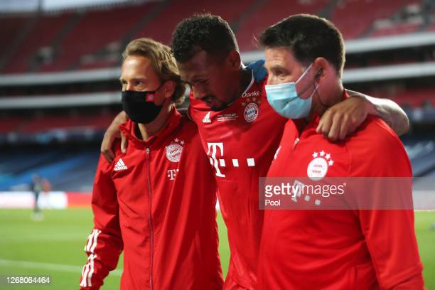 Jerome Boateng of FC Bayern Munich leaves the pitch with medical staff due to in during the UEFA Champions League Final match between Paris...