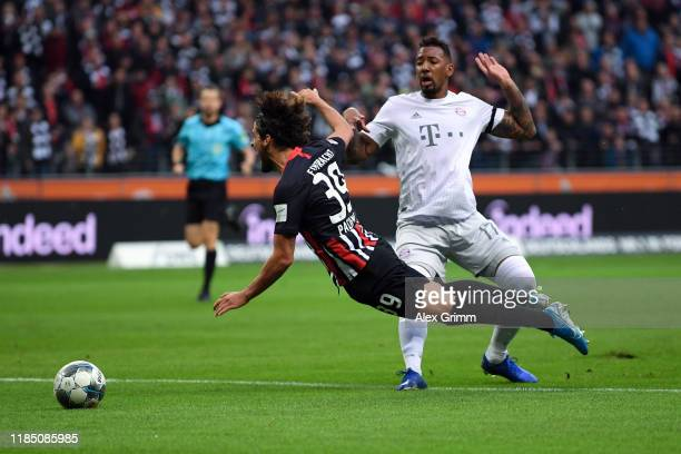 Jerome Boateng of FC Bayern Munich tackles Goncalo Paciencia of Eintracht Frankfurt which leads to a red card for Jerome Boateng during the...
