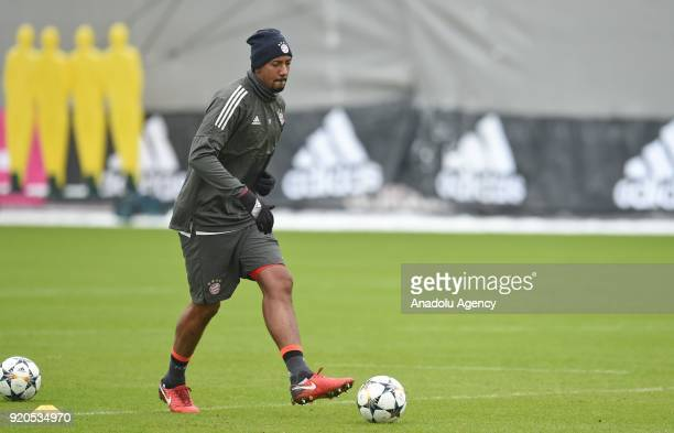 Jerome Boateng of German soccer club FC Bayern Munich passes the ball during a training session ahead of the round of 16 Champions League match...