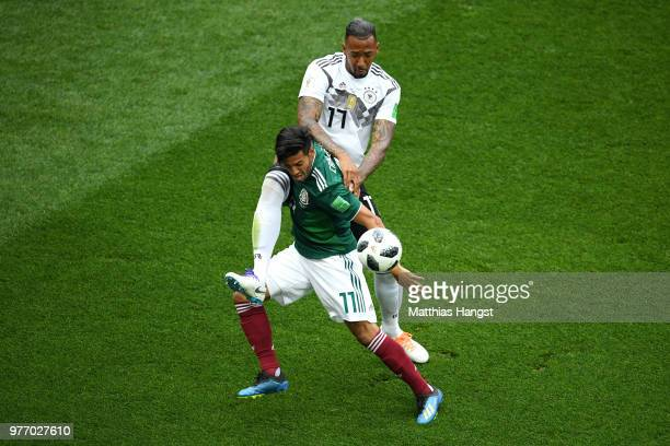 Jerome Boateng of Germany and Carlos Vela of Mexico compete for the ball in the air during the 2018 FIFA World Cup Russia group F match between...