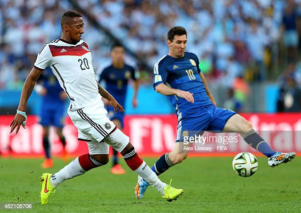 Jerome Boateng of Germany and Lionel Messi of Argentina compete for the ball during the 2014 FIFA World Cup Brazil Final match between Germany and...