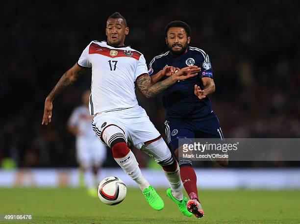 Jerome Boateng of Germany battles with Ikechi Anya of Scotland during the UEFA EURO 2016 Qualifying Group D match between Scotland and Germany at...