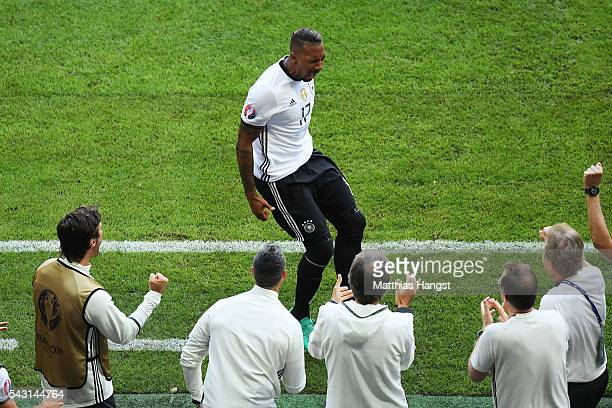 Jerome Boateng of Germany celebrates scoring his team's first goal with his team staffs and substitute players during the UEFA EURO 2016 round of 16...