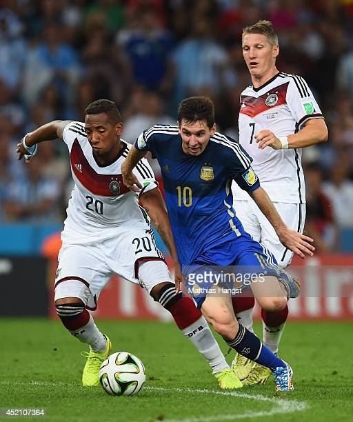 Jerome Boateng of Germany challenges Lionel Messi of Argentina during the 2014 FIFA World Cup Brazil Final match between Germany and Argentina at...