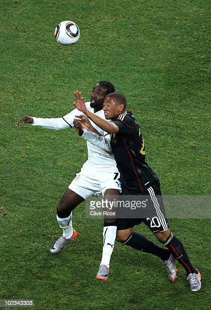 Jerome Boateng of Germany challenges Prince Tagoe of Ghana during the 2010 FIFA World Cup South Africa Group D match between Ghana and Germany at...