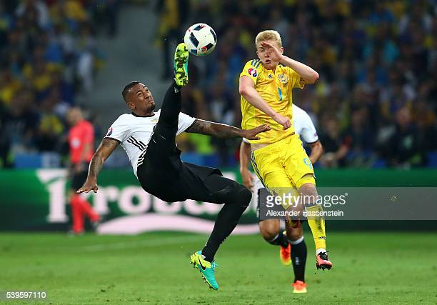 Jerome Boateng of Germany clears the ball with an overhead kick during the UEFA EURO 2016 Group C match between Germany and Ukraine at Stade...