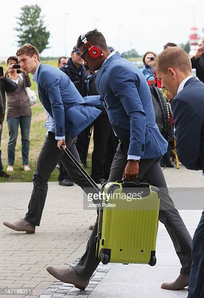 Jerome Boateng of Germany departs for their UEFA EURO 2012 semifinal match against Italy at Lech Walesa Airport at Lech Walesa Airport on June 27...
