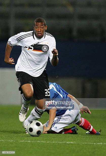 Jerome Boateng of Germany fights for the ball against Yohan Cabaye of France during the UEFA U21 Championship Playoff match between France and...