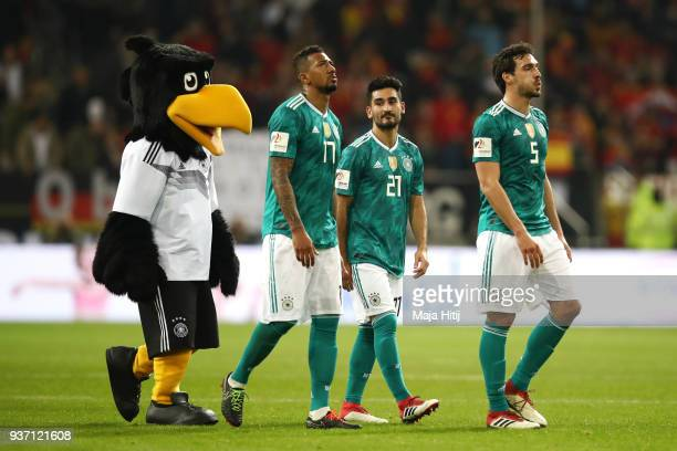 Jerome Boateng of Germany Ilkay Gundogan of Germany and Mats Hummels of Germany leave the pitch after the International friendly match between...