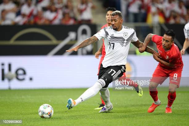 Jerome Boateng of Germany is challanged by Christian Cueva of Peru during the International Friendly match between Germany and Peru at...