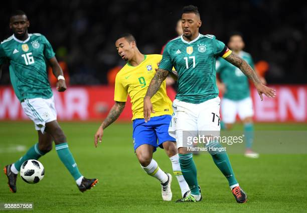 Jerome Boateng of Germany is fouled by Gabriel Jesus of Brazil and later goes off injured during the International friendly between Germany and...