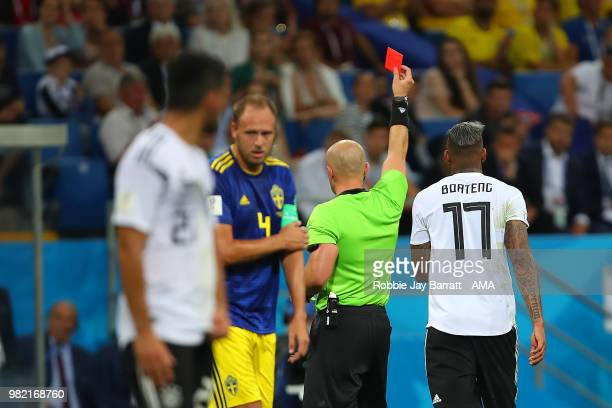 Jerome Boateng of Germany is shown a red card by Referee Szymon Marciniak during the 2018 FIFA World Cup Russia group F match between Germany and...