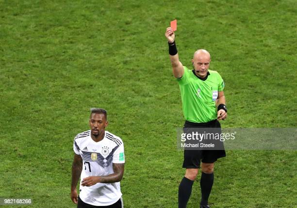 Jerome Boateng of Germany is shown a redcard by referee Szymon Marciniak during the 2018 FIFA World Cup Russia group F match between Germany and...