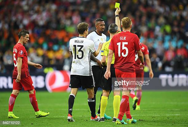 Jerome Boateng of Germany is shown a yellow card by Referee Bjorn Kulpers after fouling Arkadiusz Milik of Poland during the UEFA EURO 2016 Group C...