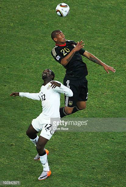 Jerome Boateng of Germany jumps for a high ball over Prince Tagoe of Ghana during the 2010 FIFA World Cup South Africa Group D match between Ghana...