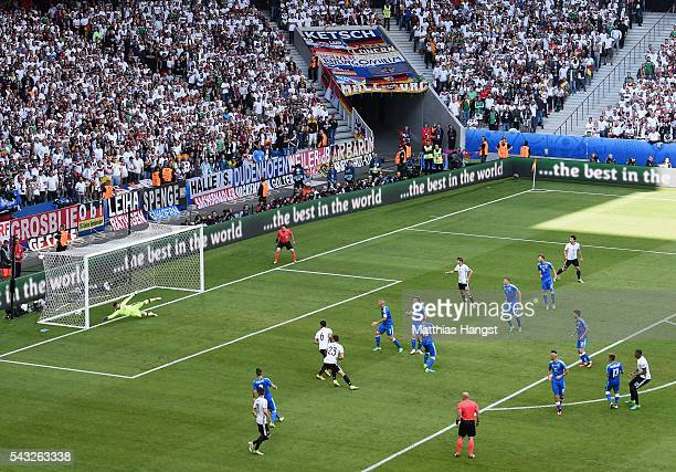 Jerome Boateng of Germany scores the opening goal during the UEFA EURO 2016 round of 16 match between Germany and Slovakia at Stade Pierre-Mauroy on...