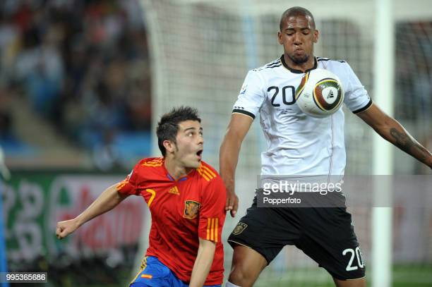 Jerome Boateng of Germany shields the ball from David Villa of Spain during the FIFA World Cup Semi Final at the Moses Mabhida Stadium on July 7 2010...