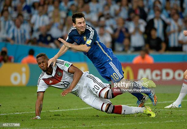 Jerome Boateng of Germany tackles Lionel Messi of Argentina during the 2014 FIFA World Cup Brazil Final match between Germany and Argentina at the...