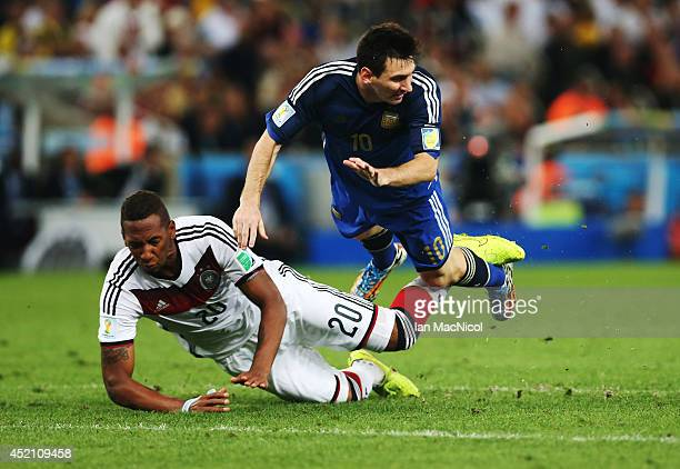 Jerome Boateng of Germany vies with Lionel Messi of Argentina during the 2014 World Cup final match between Germany and Argentina at The Maracana...