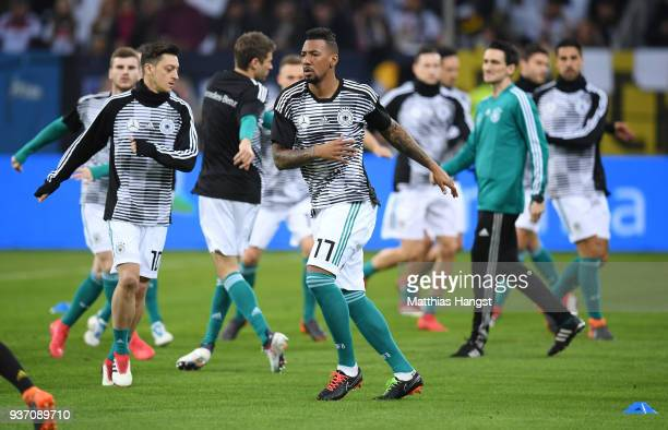 Jerome Boateng of Germany warms up prior to the International friendly match between Germany and Spain at Esprit-Arena on March 23, 2018 in...