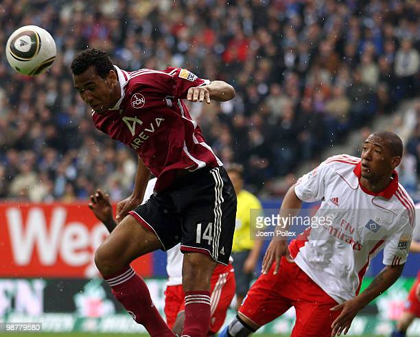 Jerome Boateng of Hamburg and Eric Maxim ChoupoMoting of Nuernberg compete for the ball during the Bundesliga match between Hamburger SV and 1 FC...