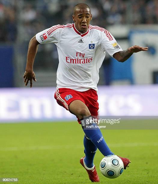 Jerome Boateng of Hamburg runs with the ball during the Bundesliga match between Hamburger SV and VfB Stuttgart at HSH Nordbank Arena on September...