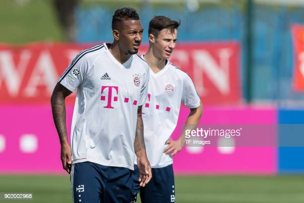 Jerome Boateng of Muenchen and Marco Friedl of Muenchen look on during the FC Bayern Muenchen training camp at Aspire Academy on January 05 2018 in...