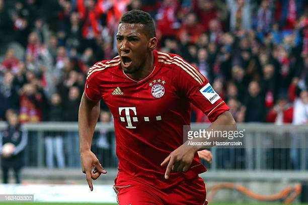 Jerome Boateng of Muenchen celebrates scoring the winning goal during the Bundesliga match between FC Bayern Muenchen and Fortuna Duesseldorf 1895 at...
