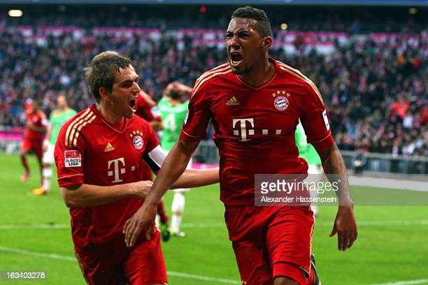Jerome Boateng of Muenchen celebrates scoring the winning goal with his team mate Philipp Lahm during the Bundesliga match between FC Bayern Muenchen...