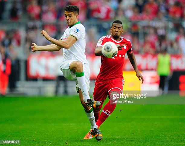 Jerome Boateng of Muenchen challenges Franco Di Santo of Bremen during the Bundesliga match between FC Bayern Muenchen and Werder Bremen at Allianz...