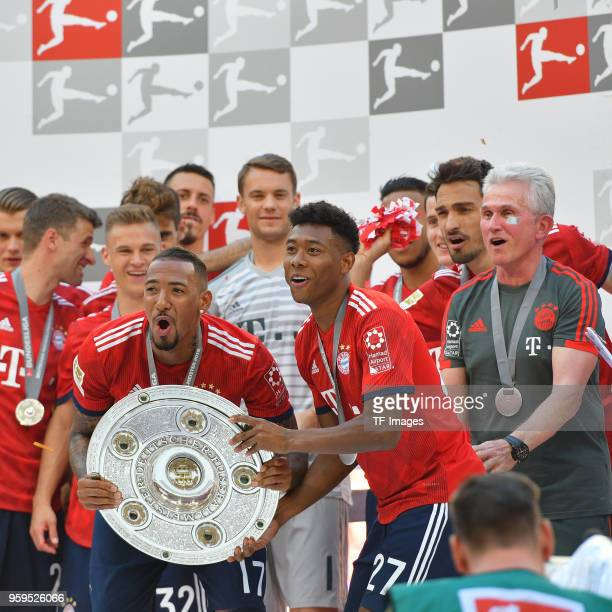 Jerome Boateng of Muenchen David Alaba of Muenchen Mats Hummels of Muenchen and Head coach Jupp Heynckes of Muenchen celebrate winning the...