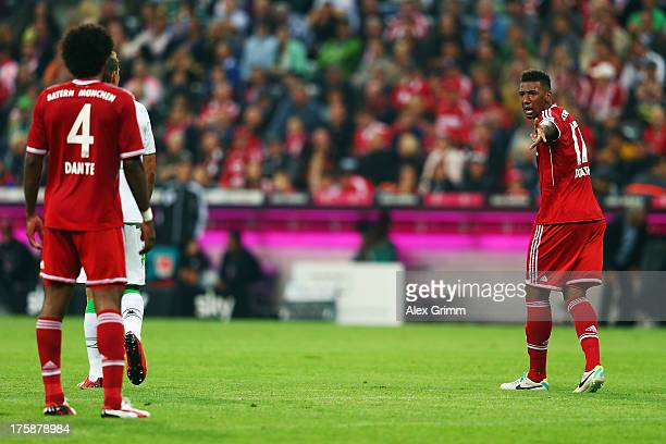 Jerome Boateng of Muenchen discusses with team mate Dante during the Bundesliga match between Bayern Muenchen and Borussia Moenchengladbach at...