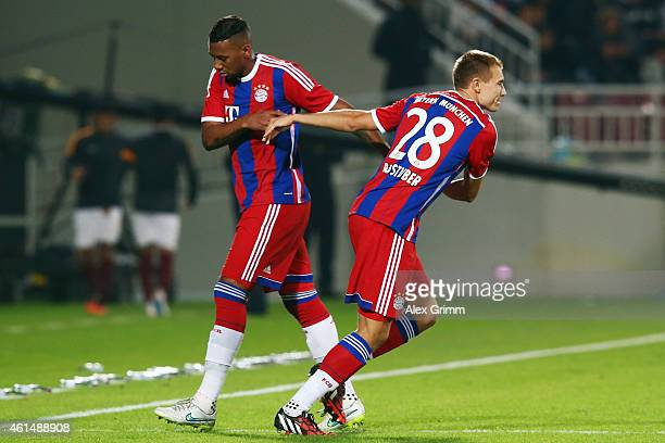 Jerome Boateng of Muenchen is replaced by Holger Badstuber during a friendly match between FC Bayern Muenchen and Qatar Stars at Abdullah bin Khalifa...