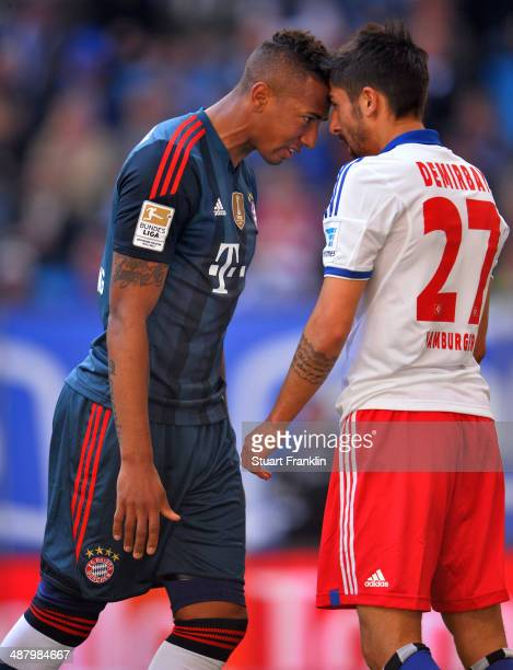 Jerome Boateng of Munechen head butts Kerem Demirbay of Hamburg during the Bundesliga match between Hamburger SV and FC Bayern Muenchen at Imtech...