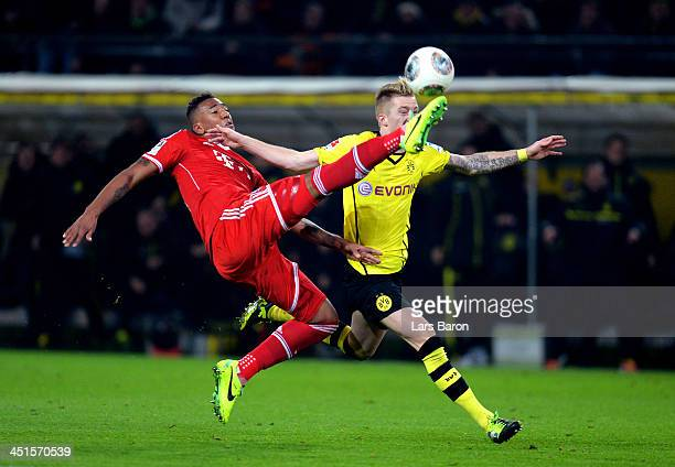 Jerome Boateng of Munich controls the ball challenged by Marco Reus of Dortmund during the Bundesliga match between Borussia Dortmund and FC Bayern...