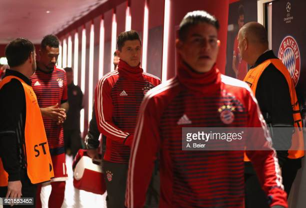 Jerome Boateng Robert Lewandowski and James Rodriguez of FC Bayern Muenchen arrive at the players' tunnel before the UEFA Champions League Round of...