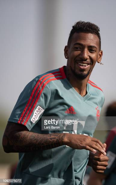 Jerome Boateng smiles during a training session at day seven of the Bayern Muenchen training camp at Aspire Academy on January 07 2019 in Doha Qatar